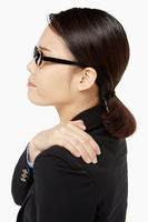 Businesswoman touching her painful shoulder