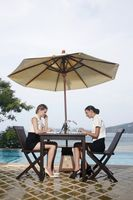 Businesswomen working together by the poolside