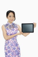 Cheerful woman holding up a digital tablet