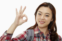 Cheerful woman showing hand gesture