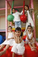 Children posing in indoor playground