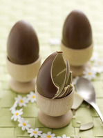 Chocolate eggs in egg cups