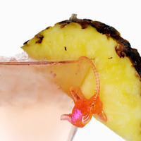 Cocktail with pineapple and pink elephant
