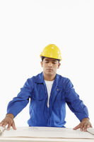 Construction worker looking at a blueprint plan