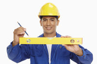Construction worker measuring with a spirit level