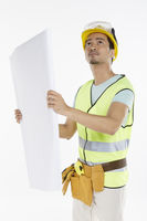 Construction worker studying the construction plan