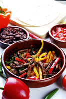Cooked mexican beef with pepper strips