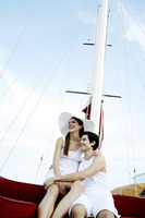 Couple cruising on a yacht