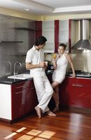 Couple enjoying beverages in the kitchen