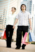 Couple holding hands while shopping