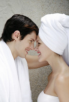 Couple in towel looking at each other