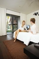 Couple playing chess in resort bedroom