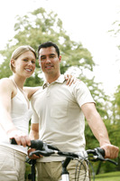 Couple posing with their bicycle