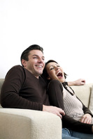 Couple sitting on the couch laughing