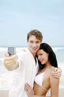 Couple taking picture on the beach