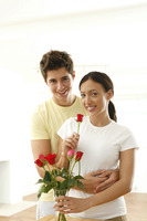 Couple with a vase of roses