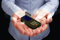 Popular : Cupped hands presenting credit card terminal