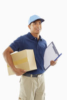 Delivery person holding a cardboard box and a clipboard