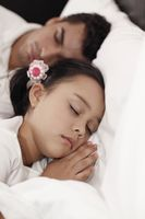 Father and daugher sleeping peacefully