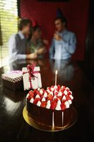 Focus on birthday cake and gifts of a birthday celebration