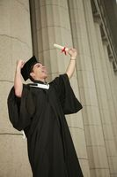 Graduate holding up his scroll and screaming
