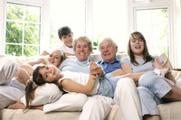 Group shot of a family spending time together in the living room