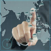 Index finger pointing at a global map