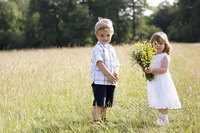 Little boy and little girl in the field