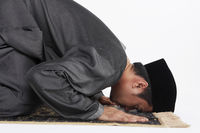 Main kneeling and staying prostrate by pressing forehead, and placing palms, knees and pads of the toes on the floor.