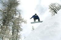 Male snowboarder in air