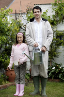 Man and girl holding watering cans