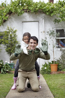 Man and girl with gardening gloves