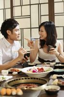 Man and woman chatting while eating in a restaurant