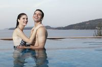 Man and woman embracing in swimming pool