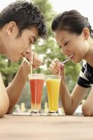 Man and woman enjoying their glasses of fruit juice
