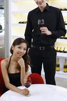 Man and woman enjoying wine