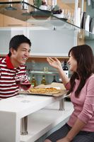 Man and woman having pizza