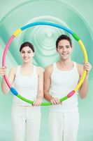 Man and woman holding a plastic hoop