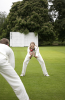 Man and woman playing cricket