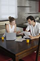 Man and woman sorting out bills together