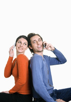 Man and woman talking on their cell phones