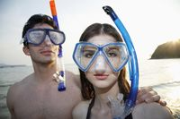 Man and woman with scuba mask
