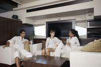 Man and women relaxing in yacht living room