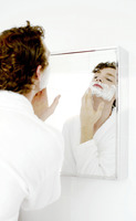 Man applying shaving cream on his face