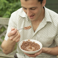 Man enjoying a bowl of breakfast cereal