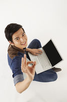 Man gesturing while using laptop