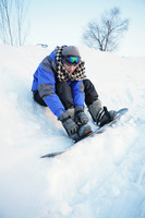 Man getting ready for snowboarding