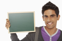 Man holding up a blank blackboard