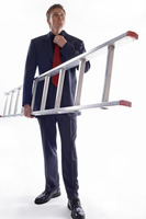 Man in business suit holding a ladder