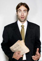 Man in business suit holding a newspaper